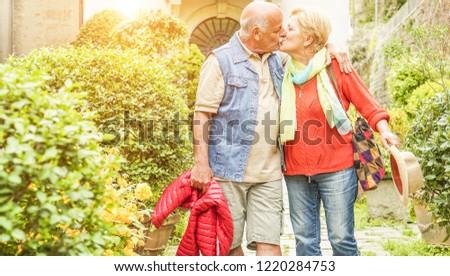 Happy senior couple in love enjoying romantic vacation for wedding anniversary celebration - Mature husband and wife having tender moments - Joyful elderly active lifestyle concept #1220284753