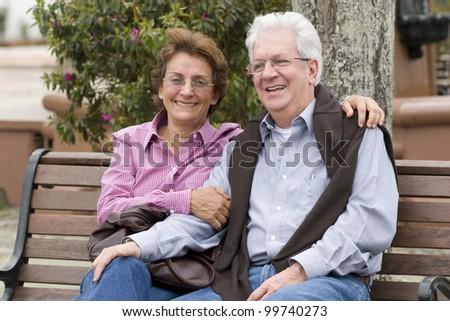 Happy Senior Couple In The Park Otdoor