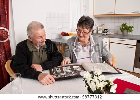 Happy senior couple looking at a photo album.