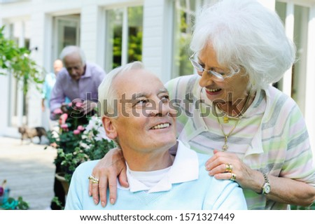 Happy senior couple looking at each other at Seniors' Living Community