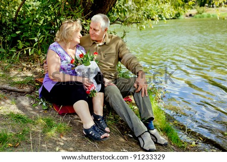 happy senior couple looking at the the river. Healthy lifestyles concept.
