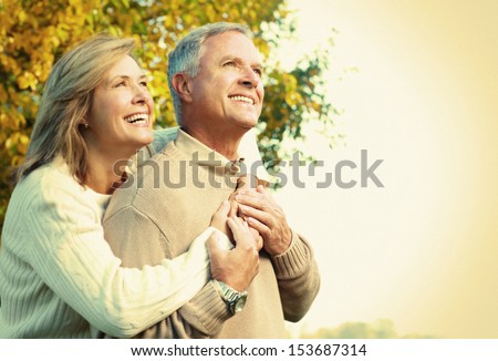 Happy senior couple relaxing in the park. #153687314