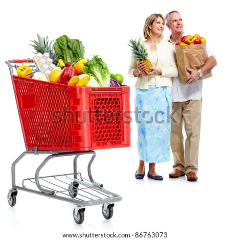Happy senior couple shopping in supermarket grocery . Isolated over white background.