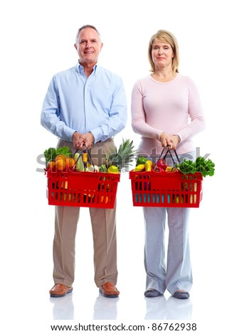 Happy senior couple with a shopping basket . Isolated over white background.