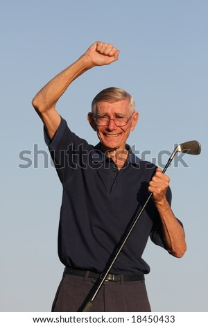 Happy Senior golfer with hand raised and smiling