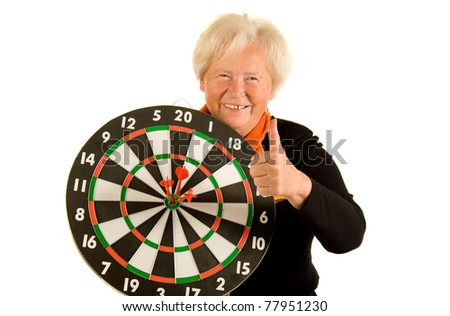 Happy senior lady with darts