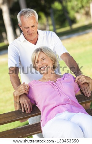 Happy senior man and woman couple smiling and laughing having fun together outside in sunshine