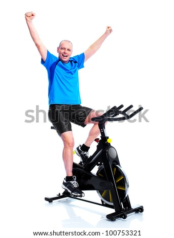 Happy senior man doing exercises. Sport and fitness. Isolated on white.