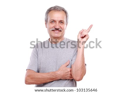 Happy senior man pointing to the copy space area