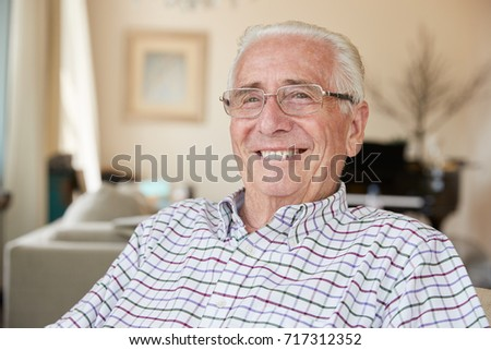 Happy senior man smiling to camera at home, close up #717312352