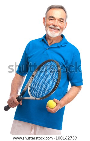 Happy senior man with a tennis racket - stock photo