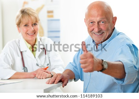 Happy senior patient and doctor at the doctor\'s office