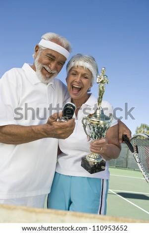 Happy senior tennis player after winning