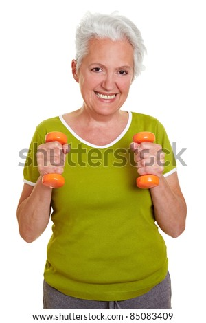 Happy senior woman exercising with two dumbbells