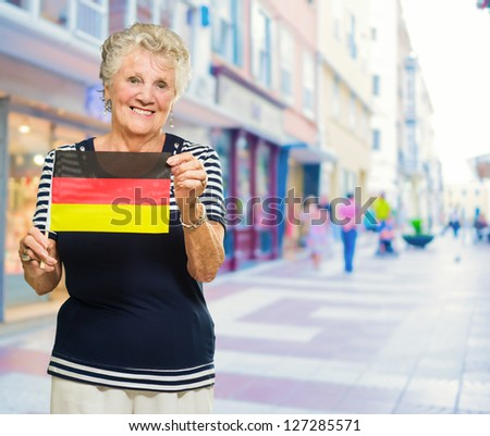 Happy Senior Woman Holding Germany Flag, Outdoors