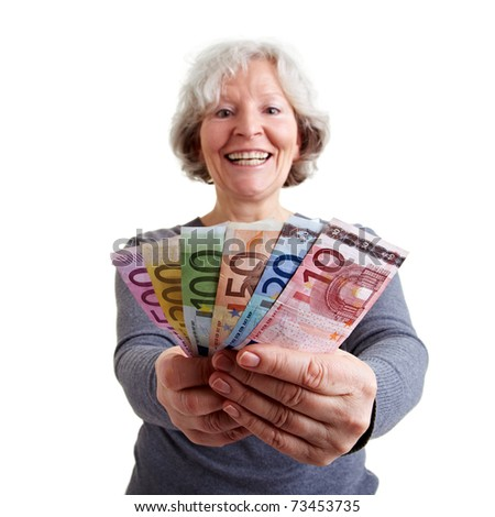 Happy senior woman holding many Euro banknotes