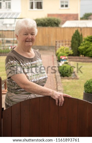 Happy senior woman in her garden   #1161893761