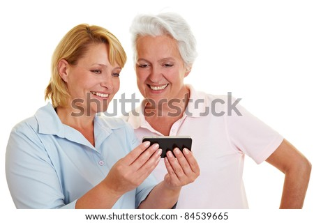 Happy senior woman looking at a smartphone