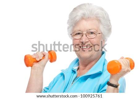 Happy senior woman making fitness training with dumbbells - stock photo