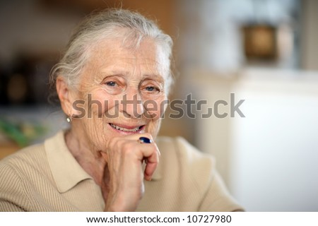 Happy senior woman portrait, close-up, shallow DOF. - stock photo
