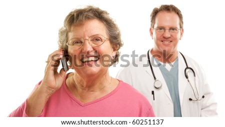 Happy Senior Woman Using Cell Phone with Male Doctor or Nurse Behind Isolated on a White Background.