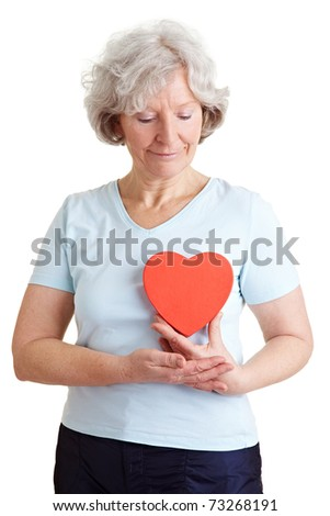 Happy senior woman with a healthy red heart