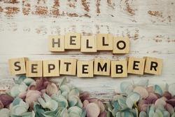 Happy September alphabet letters on wooden background