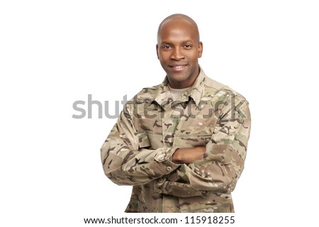 Happy serviceman with his arms crossed