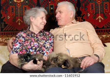happy seventy year old couple with cat