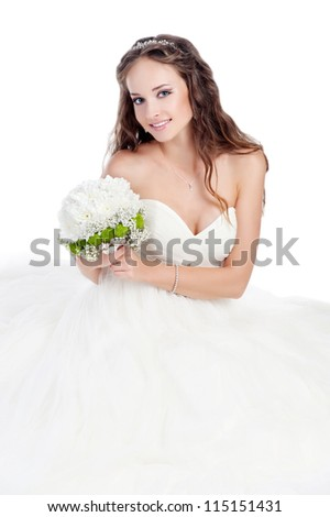 Happy sexy beautiful bride blond girl in white wedding dress with hairstyle and bright makeup