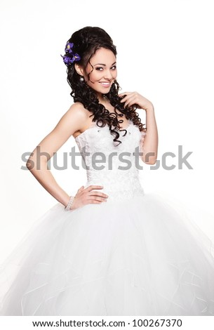 Happy sexy beautiful bride brunette girl in white wedding dress with hairstyle and bright makeup on white background