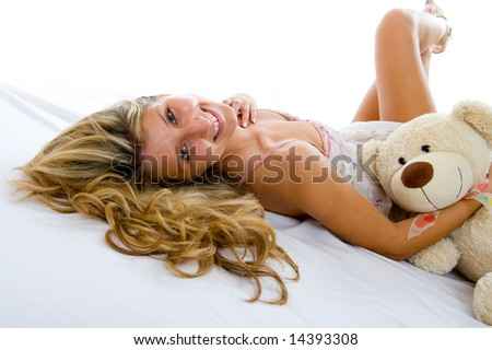 stock photo happy sexy girl with teddy bear lays on a bed and relax 14393308 Funny adult flash game desire   sexy extreme gymnast