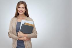 Happy shcool teacher holding books. Isolated professional portrait.