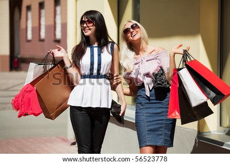 Happy shoppers on a city street.