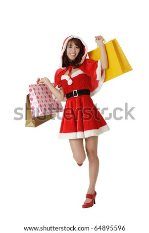 Happy shopping Christmas woman with bags isolated over white.