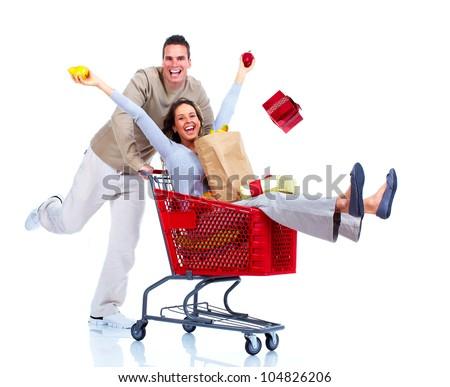 Happy shopping couple. Isolated on white background.