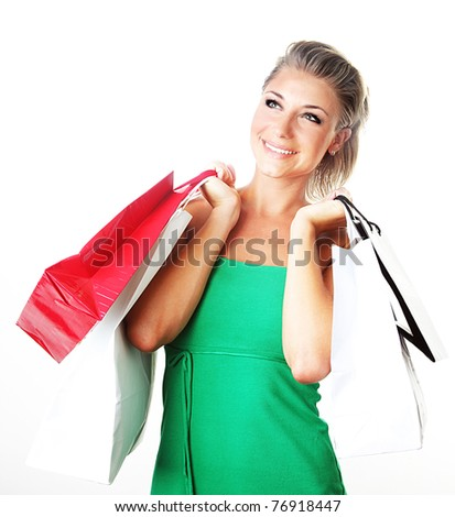 Happy shopping girl carrying new bags, spending money concept