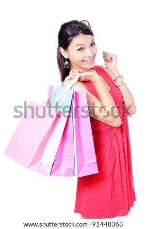 Happy Shopping Girl Holding bag isolated on white background, Model is a asian beauty