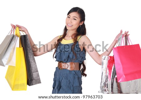 Happy shopping woman holding bags isolated over white.