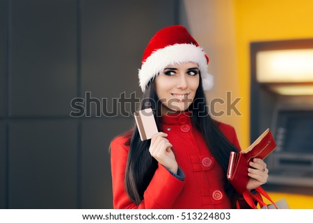 Happy Shopping Woman Holding Credit Card in front of an ATM - Cute shopper girl spending wisely   #513224803