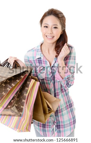 Happy shopping woman of Asian holding bags against white background.