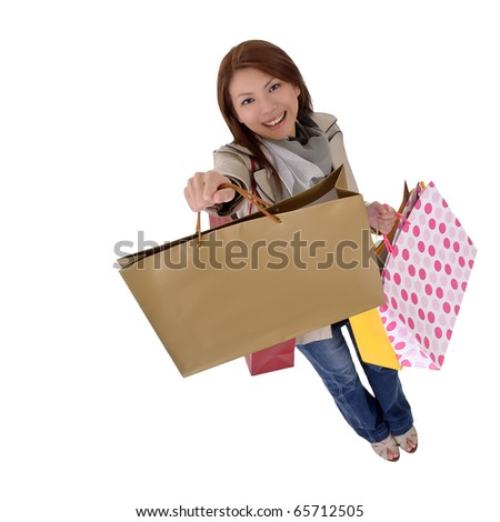 Happy shopping woman show her bags and smiling isolated over white.