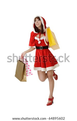 Happy shopping woman walking in Santa Claus clothes isolated over white.