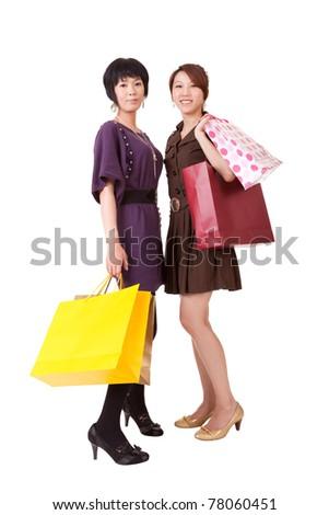 Happy shopping women, full length portrait isolated on white background.