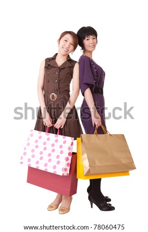 Happy shopping women holding bags, full length portrait isolated on white background.