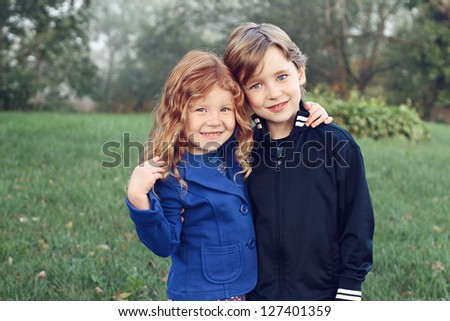 Happy siblings with arms around each other