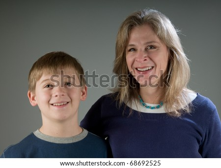 Happy single mom with her ten year old son