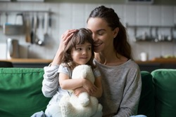 Happy single mother hugging cute daughter showing care support, young smiling mom or sister embracing girl feeling gratitude love, mum and kid sincere warm relations, mommy and child family concept