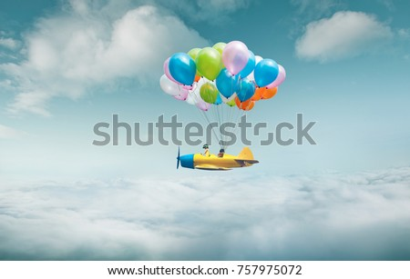 Happy sister enjoy with fantasy plane fly  and floating in sky with bunch of colorful balloons . - Shutterstock ID 757975072