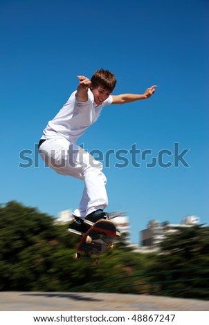 Happy skateboarder on a jump